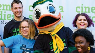 Students with the University of Oregon Duck Mascot