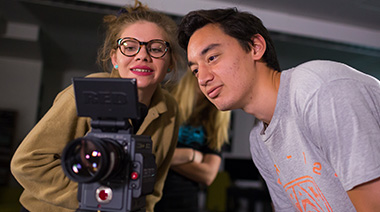 Two students looking through a RED camera