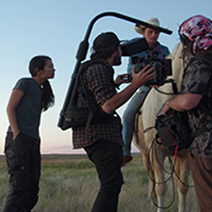 "Photo of Chloe Zhao directing ""The Rider"" film"