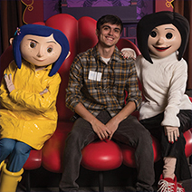 """Matthew Thill volunteering at """"Bring Your Child to Work Day"""" at the Coraline Marketing Unit. Photo by: Steven Wong Jr."""